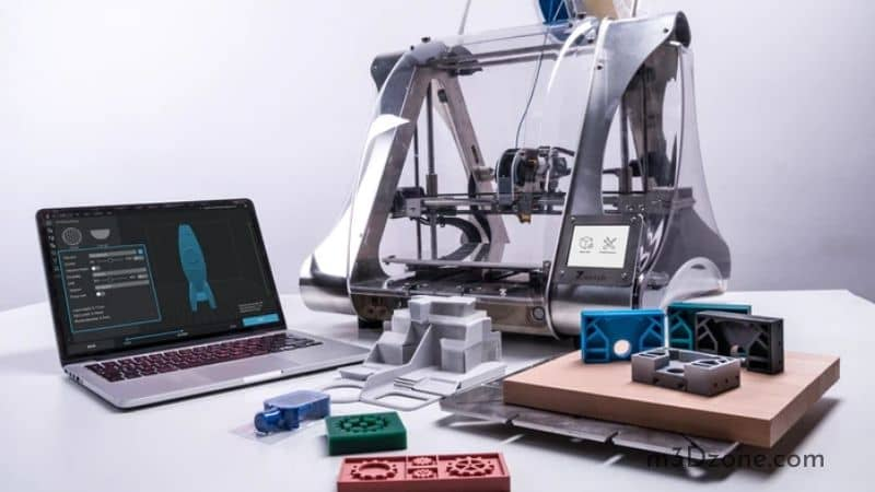 Laptop, 3D printer & 3D Printed Objects On A Desk